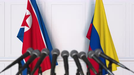dprk : Flags of North Korea and Colombia at international meeting or negotiations press conference Stock Footage