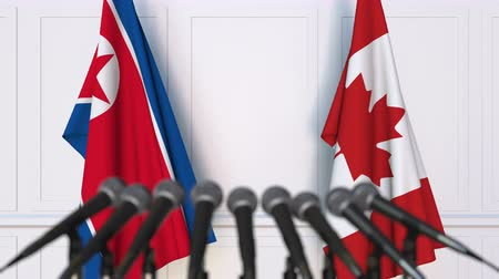 dprk : Flags of North Korea and Canada at international meeting or negotiations press conference Stock Footage