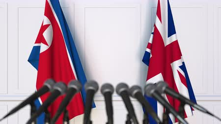 dprk : Flags of North Korea and The United Kingdom at international meeting or negotiations press conference