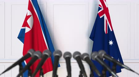 north korean flag : Flags of North Korea and Australia at international meeting or negotiations press conference