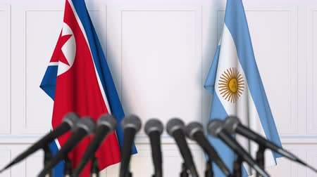 north korean flag : Flags of North Korea and Argentina at international meeting or negotiations press conference Stock Footage