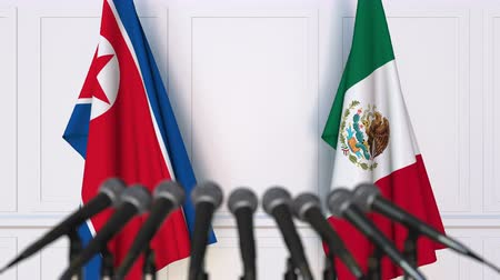 dprk : Flags of North Korea and Mexico at international meeting or negotiations press conference Stock Footage