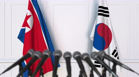 north korean flag : Flags of North Korea and Korea at international meeting or negotiations press conference