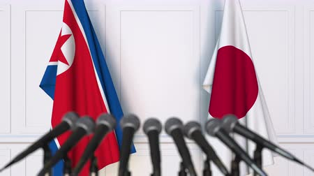 north korean flag : Flags of North Korea and Japan at international meeting or negotiations press conference