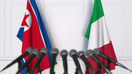 north korean flag : Flags of North Korea and Italy at international meeting or negotiations press conference