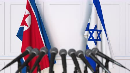 north korean flag : Flags of North Korea and Israel at international meeting or negotiations press conference