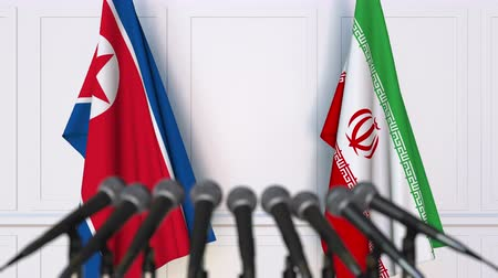 north korean flag : Flags of North Korea and Iran at international meeting or negotiations press conference