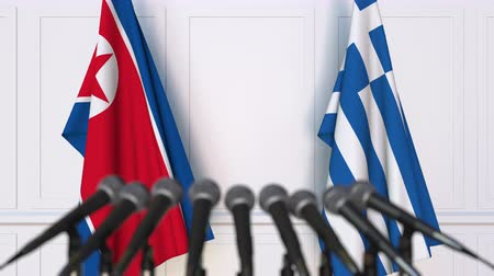 north korean flag : Flags of North Korea and Greece at international meeting or negotiations press conference