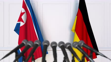 north korean flag : Flags of North Korea and Germany at international meeting or negotiations press conference
