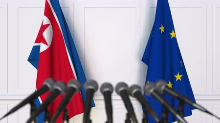 north korean flag : Flags of North Korea and the European Union at international meeting or negotiations press conference