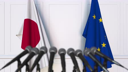 negocjacje : Flags of Japan and the European Union at international meeting or negotiations press conference