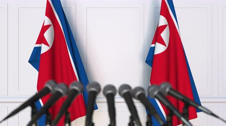 north korean flag : North Korean official press conference. Flags of North Korea and microphones. Conceptual animation
