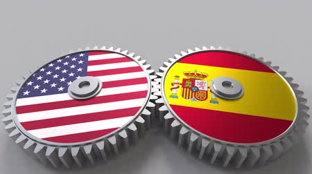 spaniard : Flags of the USA and Spain on meshing gears. International cooperation conceptual animation