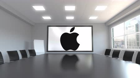 apple headquarter : Apple Inc. logo on the screen in a meeting room. Editorial 3D animation Stock Footage