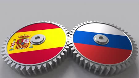spaniard : Flags of Spain and Russia on meshing gears. International cooperation conceptual animation
