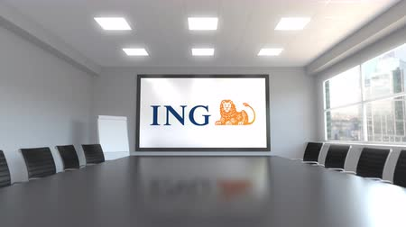 ing : ING Group logo on the screen in a meeting room. Editorial 3D animation