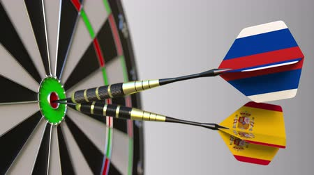 spaniard : Flags of Russia and Spain on darts hitting bullseye of the target. International cooperation or competition conceptual animation Stock Footage