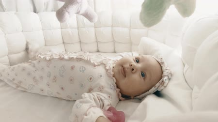 unrest : Adorable newborn baby girl in her cot Stock Footage