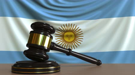 licit : Judges gavel and block against the flag of Argentina. Argentinian court conceptual animation