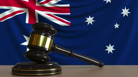 licit : Judges gavel and block against the flag of Australia. Australian court conceptual animation Stock Footage