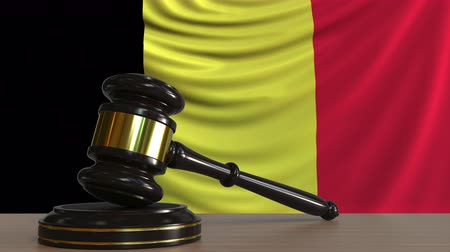 licit : Judges gavel and block against the flag of Belgium. Belgian court conceptual animation