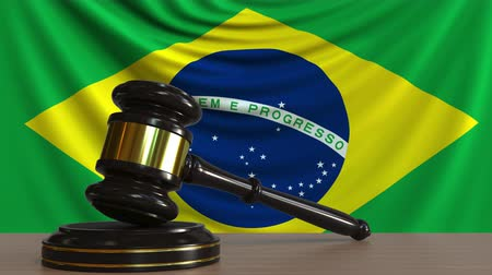 licit : Judges gavel and block against the flag of Brazil. Brazilian court conceptual animation