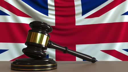 licit : Judges gavel and block against the flag of Great Britain. British court conceptual animation Stock Footage
