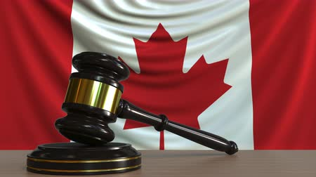 licit : Judges gavel and block against the flag of Canada. Canadian court conceptual animation