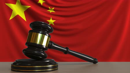 licit : Judges gavel and block against the flag of China. Chinese court conceptual animation