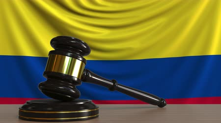 licit : Judges gavel and block against the flag of Colombia. Colombian court conceptual animation