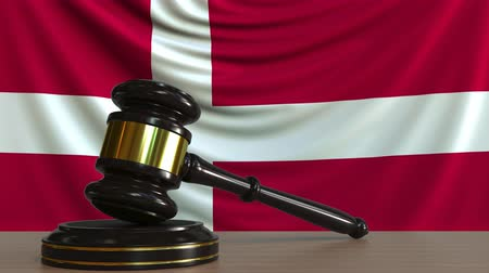 licit : Judges gavel and block against the flag of Denmark. Danish court conceptual animation Stock Footage