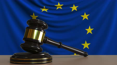 licit : Judges gavel and block against the flag of the European Union. Court conceptual animation Stock Footage