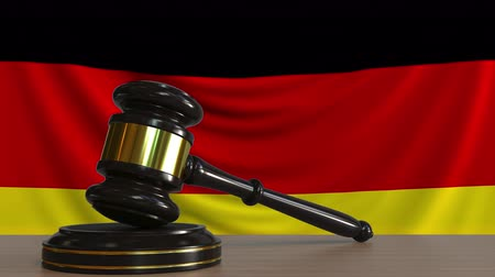 licit : Judges gavel and block against the flag of Germany. German court conceptual animation Stock Footage