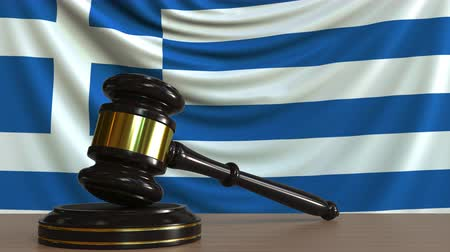 licit : Judges gavel and block against the flag of Greece. Greek court conceptual animation