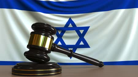 licit : Judges gavel and block against the flag of Israel. Israeli court conceptual animation