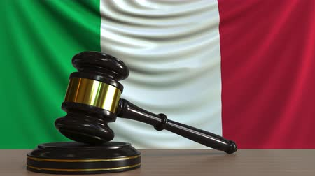 licit : Judges gavel and block against the flag of Italy. Italian court conceptual animation