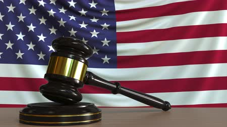 licit : Judges gavel and block against the flag of the United States. American court conceptual animation