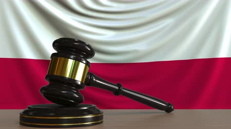 licit : Judges gavel and block against the flag of Poland. Polish court conceptual animation