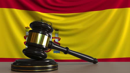 licit : Judges gavel and block against the flag of Spain. Spanish court conceptual animation Stock Footage