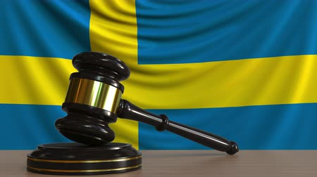 licit : Judges gavel and block against the flag of Sweden. Swedish court conceptual animation Stock Footage