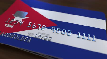 fraudulent : Plastic bank card featuring flag of Cuba. Cuban banking system conceptual animation Stock Footage
