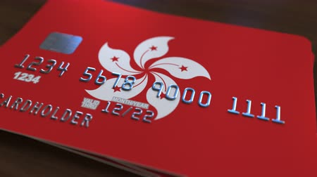 fraudulent : Plastic bank card featuring flag of Hong Kong. Banking system conceptual animation Stock Footage