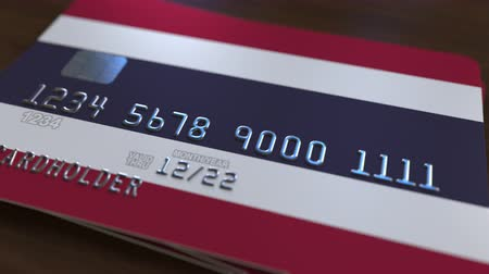 fraudulent : Plastic bank card featuring flag of Thailand. Thai banking system conceptual animation