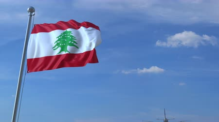 göçmen : Commercial airplane flying above waving flag of Lebanon. Lebanese emigration or tourism related animation