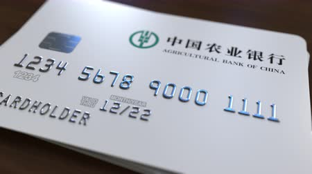 fraudulent : Plastic card with logo of Agricultural Bank of China. Editorial conceptual 3D animation