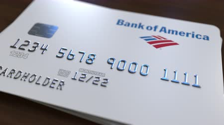 fraudulent : Plastic card with logo of Bank of America. Editorial conceptual 3D animation Stock Footage