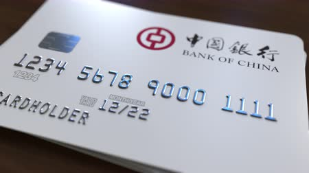 fraudulent : Plastic card with logo of Bank of China. Editorial conceptual 3D animation