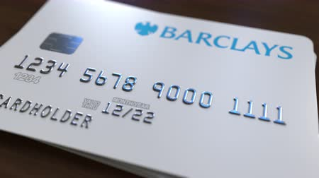 fraudulent : Plastic bank card with logo of Barclays. Editorial conceptual 3D animation Stock Footage