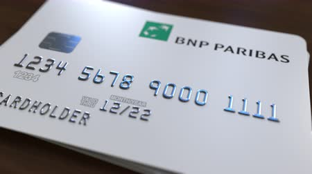 fraudulent : Plastic bank card with logo of BNP Paribas. Editorial conceptual 3D animation