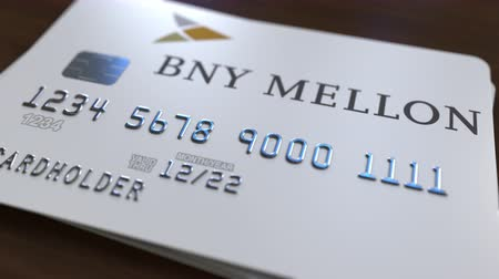 fraudulent : Plastic card with logo of the Bank of New York Mellon BNY. Editorial conceptual 3D animation